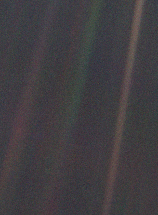 The famous photograph of Earth taken by the Voyager spacecraft on its way out of the solar system, in which Earth appears as a tiny, pale blue dot
